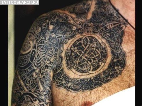 Тату в стиле славянской мифологии на плече